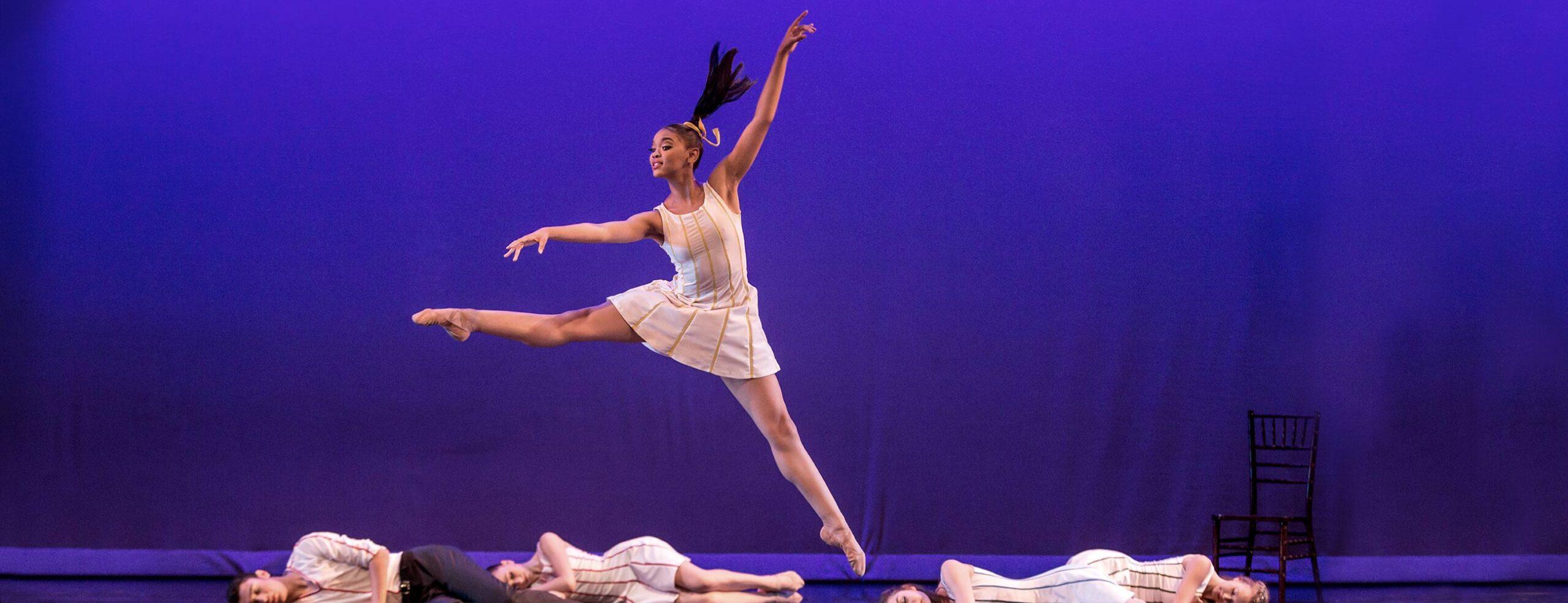 Ballet dancer jumping on stage