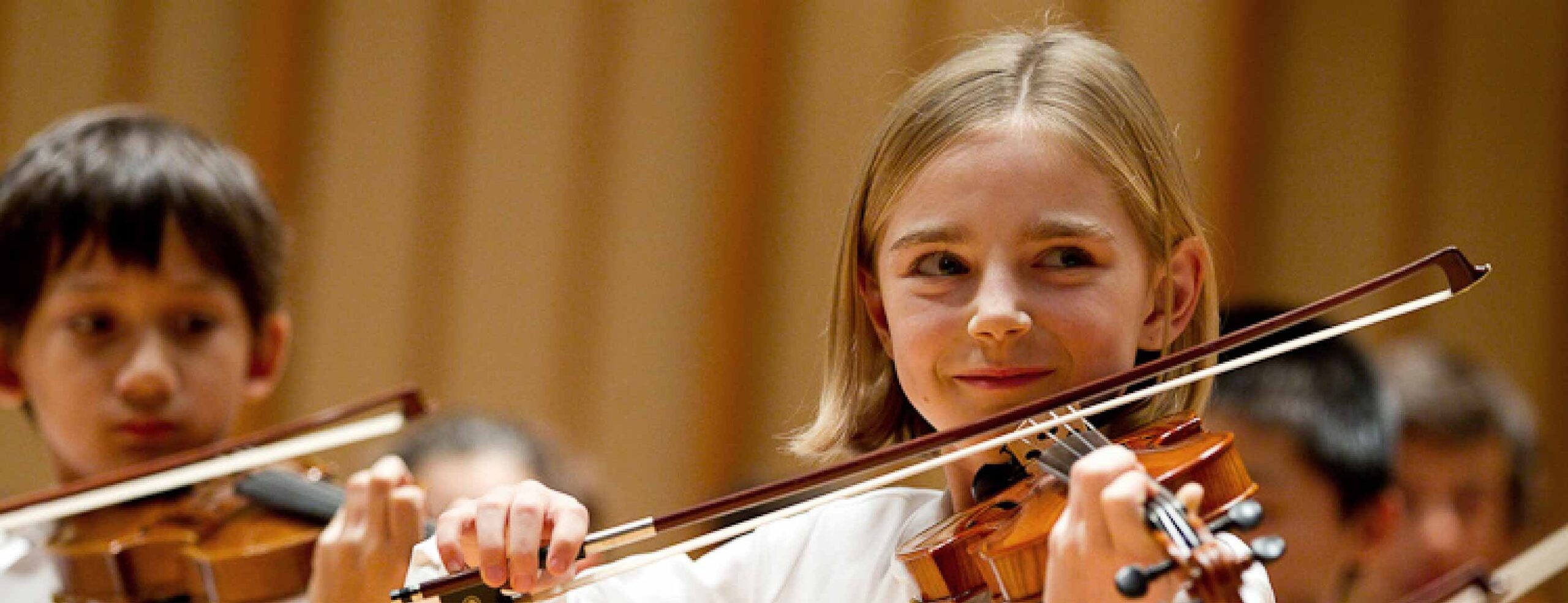 Young violinists on stage